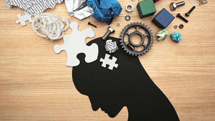 silhouette man with gears and puzzle pieces above his head