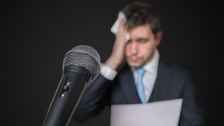 Image of a man scared of speaking in front of crowd