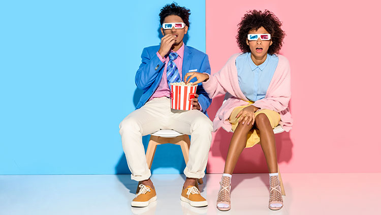Man and woman wearing 3D glasses
